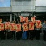 Court delays sentencing women in airport protest for fourth time