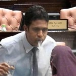 Majority leader spits at female opposition MP