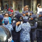 Police disperse labour day protest