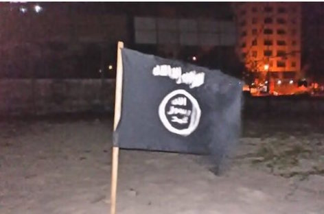 Man arrested for raising Islamic State flag