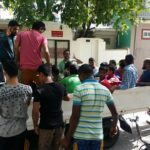 Almost 100 expats detained for screening