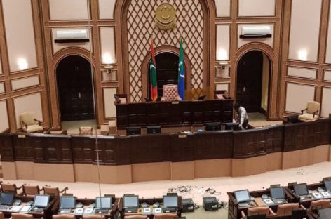 Majlis continues over din of opposition protest