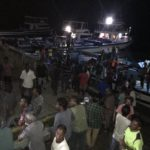 High and dry: fishermen queue to weigh their catch