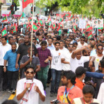 Three May Day detainees sue state over trial delay